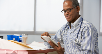 black-male-doctor-with-ipad